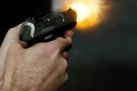 Armas: revólver sendo disparado (George Frey/Bloomberg/)